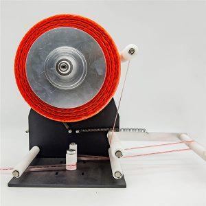 Stroj na držení pásky